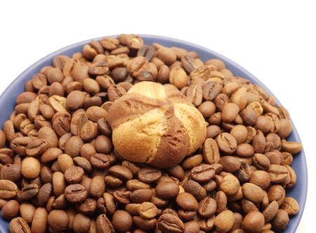 Coffee grains and cookies in a blue cup on a white background photo