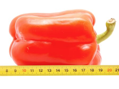 Pepper and ruler on a white background  photo