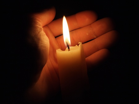 hands fire passion: hand with candle Stock Photo