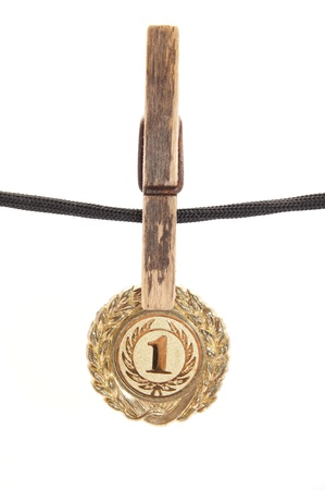 medal, clothespin and rope on a white background photo