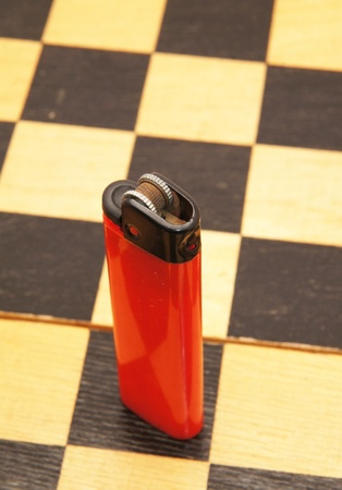 lighter red on a chess board photo