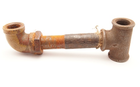 Old a pipe on a white background