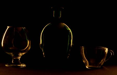 Bottle and glass on a black background photo