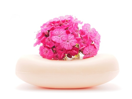 Carnation and soap on a white background photo
