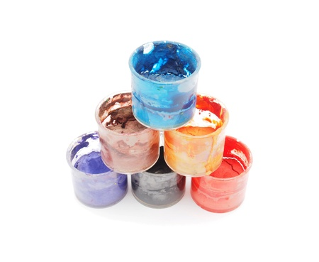 cans of paint on a white background photo