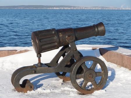 chernigow: Gun on quay of Onega in Petrozavodsk, Russia  Editorial