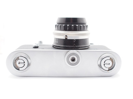 Old camera on a white background Stock Photo - 17568498