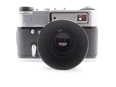 Old camera on a white background Stock Photo - 17568511