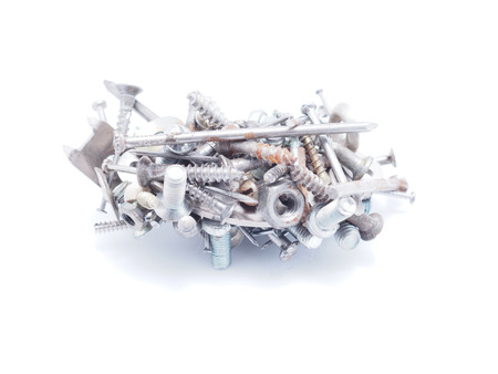 Nails, screws and nuts on a white background photo