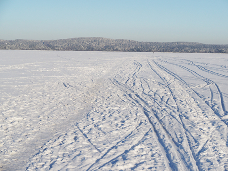 trails on the lake in winter photo