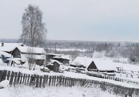 Winter in Russian village photo