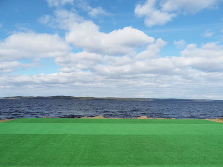 landscaping riverside: artificial turf on the lake