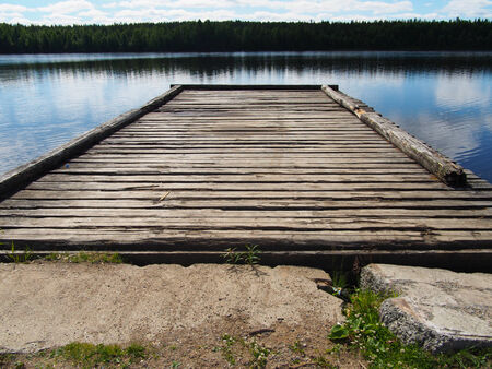 the bigger picture: old pier on the river
