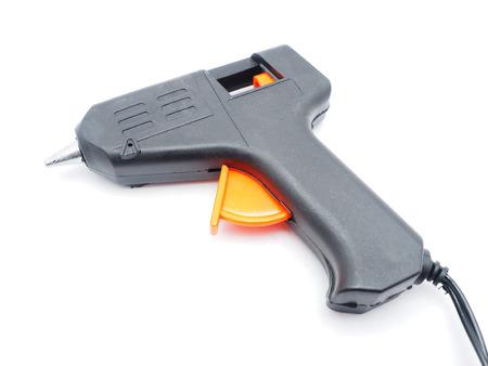 affix: glue gun on a white background