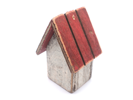 garden settlement: Toy wooden house on a white background