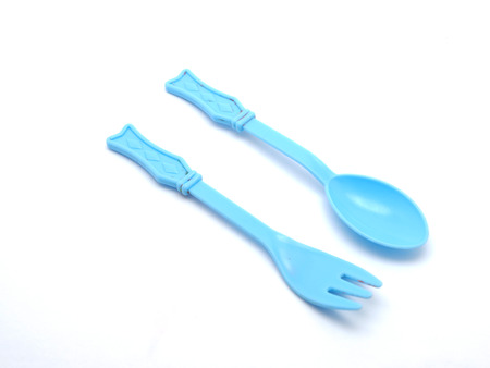baby spoon: Plastic baby spoon on a white background Stock Photo