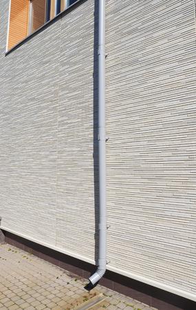 rainwater: rainwater pipe in the house Stock Photo