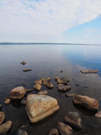 sand harbor: Stones on the lake Stock Photo