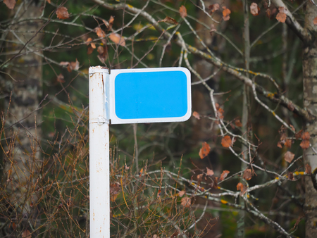red sign: km blank sign in the forest