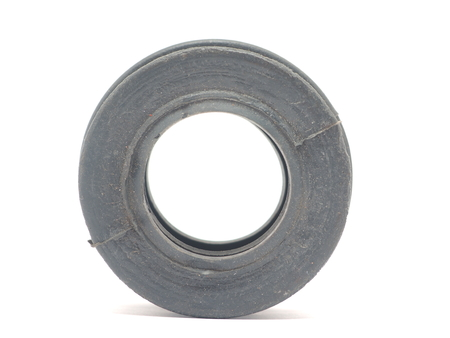 rubber gasket: black rubber plumbing collar on a white background