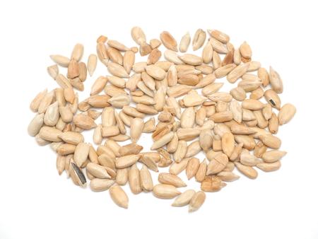 sunflower seeds: Peeled sunflower seeds on a white background