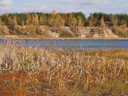 flooded: flooded quarry in autumn Stock Photo