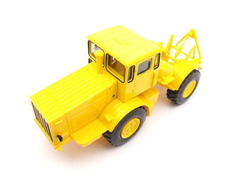earthmoving: toy grader on a white background Stock Photo