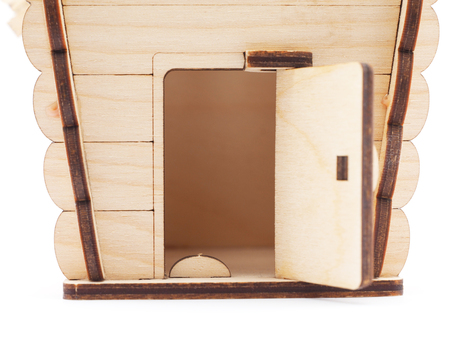 immovable: Wooden toy house on a white background