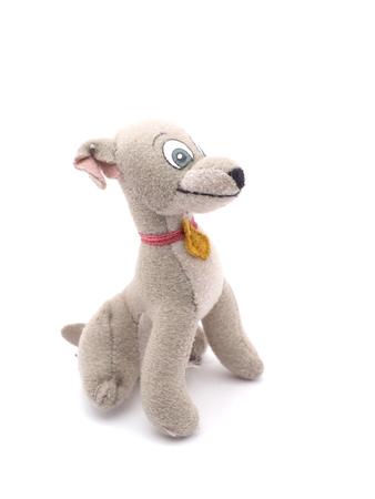 snugly: soft toy dog on a white background