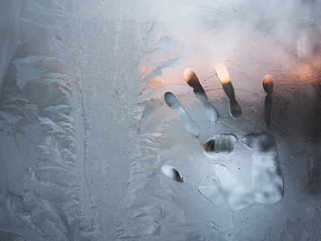 trace their hands on a frozen glass