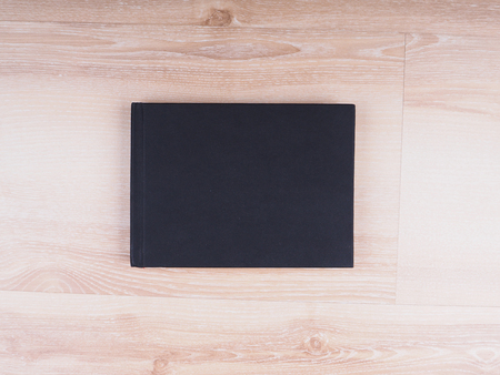 hard bound: black notes on the wooden background Stock Photo