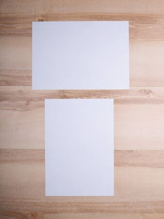 a4 background: A4 paper on a wooden background