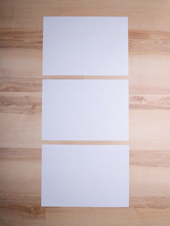a4: A4 paper on a wooden background