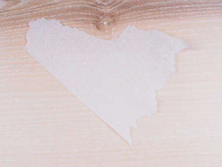 woodgrain: piece of paper on a wooden background Stock Photo