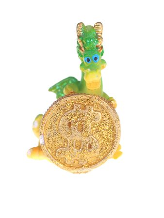 playtime: toy dragon with a coin on a white background