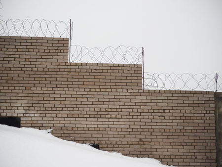 wire fence: fence with barbed wire Stock Photo