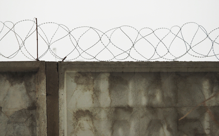 barb: fence with barbed wire Stock Photo