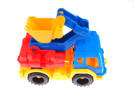heave: toy truck with a bucket on a white background