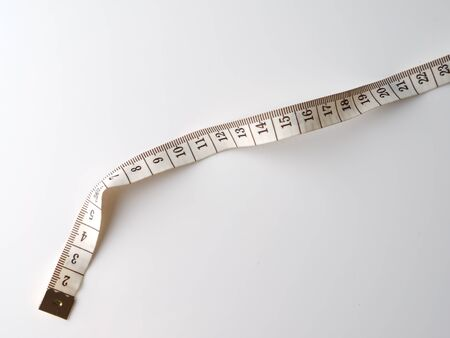 cm: measuring tape on a gray background Stock Photo