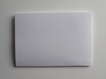 a4 background: paper a4 on a grey background Stock Photo