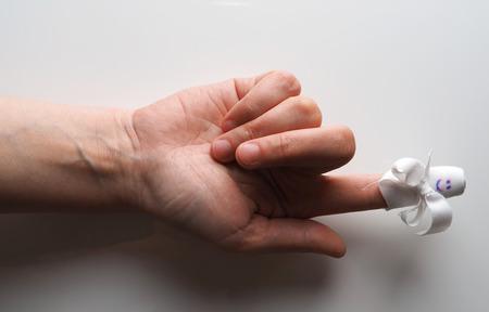 bandaged: bandaged finger on a gray background