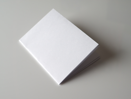 folded paper: folded paper on a gray background