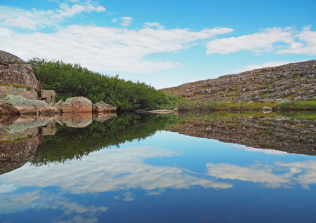 ladoga: reflection in the lake. The coast of the Barents Sea