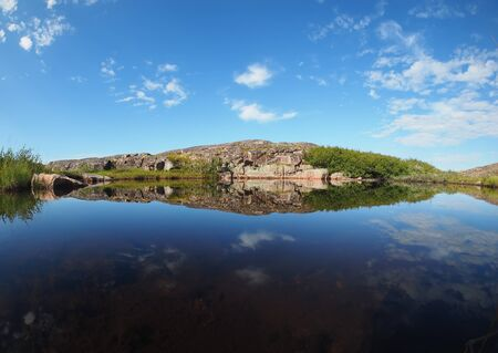 reflection in the lake. The coast of the Barents Sea