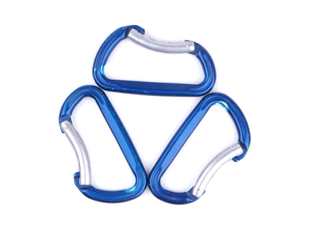 rapell: blue climbing carabiners on a white background Stock Photo