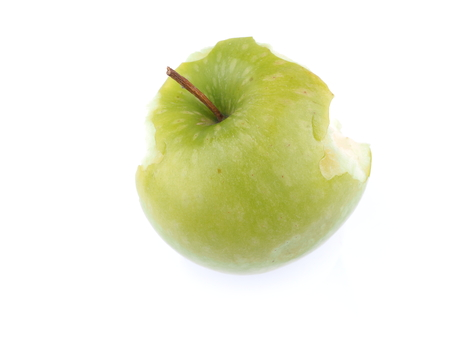 bitten green apple on a white background Stock Photo