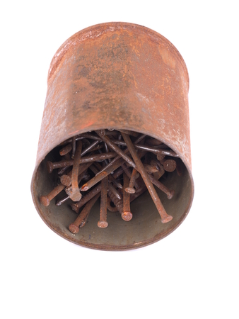 Old rusty nails on a white background