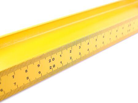 spirit level: Yellow level on a white background Stock Photo