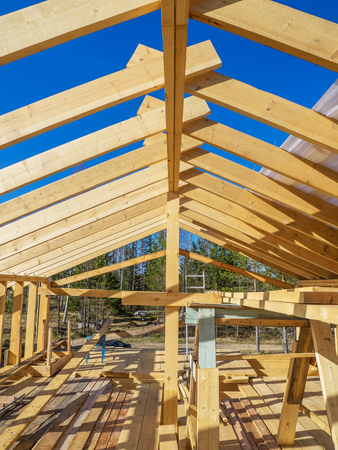 unfinished building: Construction of a frame house Stock Photo
