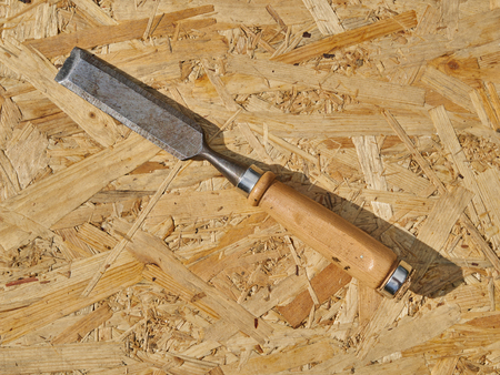 Chisel on a wooden background